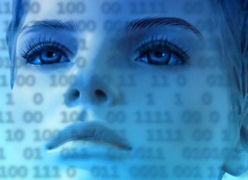 Image of woman's face overlaid with binary code.