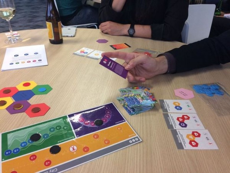 Photo of people playing Datopolis game.